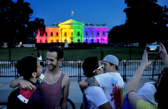 WASHINGTON, DC- JUNE 26: Homosexuals celebrate in front of the White House (now, the Sodomites House) that was lit in LGBT rainbow colored lights tonight to honor the Supreme Court decision to allow gay marriage. (Getty Images)